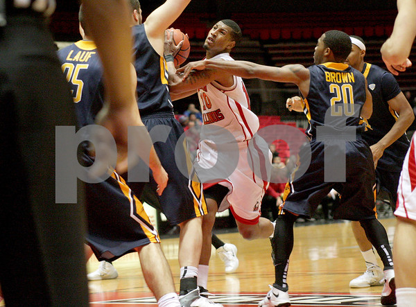 Monica Maschak - mmaschak@shawmedia.com<br /> Northern Illinois' Darrell Bowie fights through the reach of the defenders in the second half against Toledo on Wednesday, February 26, 2014. The Huskies won, 74-66.