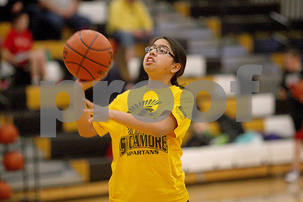 Monica Maschak - mmaschak@shawmedia.com<br /> Ashley Montano, 12, launches the ball during a free throw contest at Sycamore High School on Saturday, January 4, 2014. Montano finished second in her age group.