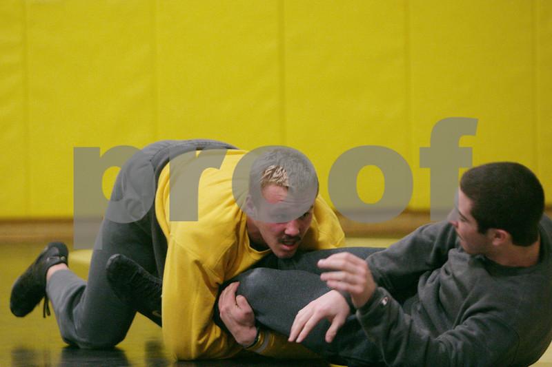 Rob Winner – rwinner@shawmedia.com<br /> <br /> Seniors Tyler Barton (left) and Austin Armstrong wrestle during practice at Sycamore High School on Thursday, Jan. 2, 2014.
