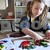 Andrea Azzo – aazzo@shawmedia.com<br /> <br /> Liliana Jennings, 7, of Sycamore, mixes different paints during her family's craft day.