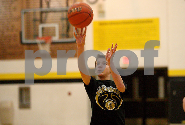 Monica Maschak - mmaschak@shawmedia.com<br /> Griffin Nelson, 13, fires the ball at the hoop during a free throw contest at Sycamore High School on Saturday, January 4, 2014. Nelson finished third in his age group.