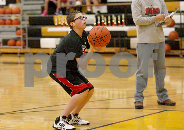 Monica Maschak - mmaschak@shawmedia.com<br /> Brendan Fritz, 13, springs up for the hoop during a free throw contest at Sycamore High School on Saturday, January 4, 2014. Fritz finished first in his age group and will advance to the district round in two weeks at Princeton High School.