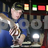 Rob Winner – rwinner@shawmedia.com<br /> <br /> Mick Vogelzang (left) of Trouble Free Lighting demonstrates a light-emitting diode utility bulb for Darrell Schaefer of Milwaukee, Wis., during the annual Northern Illinois Farm Show at the Convocation Center in DeKalb, Ill., Wednesday, Jan. 8, 2014.