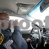Monica Maschak - mmaschak@shawmedia.com<br /> DeKalb County Sheriff Sergeant Van Bomar communicates with dispatch from his squad car on Tuesday, January 7, 2014.