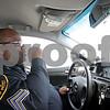 Monica Maschak - mmaschak@shawmedia.com<br /> DeKalb County Sheriff Sergeant Van Bomar communicates with dispatch from his squad car on Tuesday, January 7, 2014.