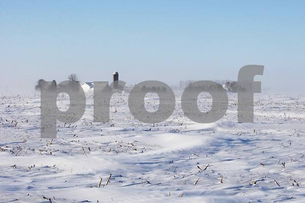 Rob Winner – rwinner@shawmedia.com<br /> <br /> A farm is seen through blowing snow in Pierce Township on Monday, Jan. 6, 2014.