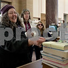 Monica Maschak - mmaschak@shawmedia.com<br /> Lori Jones checks out books at DeKalb Library on Thursday, January 2, 2014.