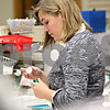 Monica Maschak - mmaschak@shawmedia.com<br /> Pharmacy Technician Karen Lehan fills prescriptions at Lehan Drugs on Thursday, January 2, 2014.