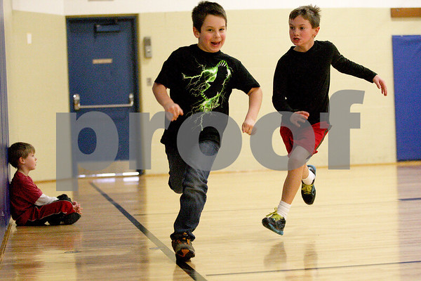 Monica Maschak - mmaschak@shawmedia.com<br /> Simone Guthrie, 7, runs from Lucas Darmstadt, 8, in a game of tag during the No School, No Problem program at Kishwaukee YMCA on Tuesday, January 7, 2014. The program is offered to kids with working parents when schools are closed.