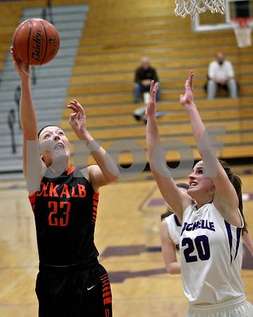 Monica Maschak - mmaschak@shawmedia.com<br /> DeKalb's Madelyne Johnson shoots for two in the second quarter at Rochelle on Friday, January 10, 2014. DeKalb won, 54-38.