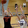 Monica Maschak - mmaschak@shawmedia.com<br /> DeKalb's Madelyne Johnson shoots for two in the second quarter at Rochelle on Friday, January 10, 2014. DeKalb won, 54-38.