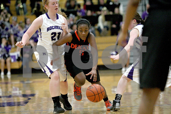 Monica Maschak - mmaschak@shawmedia.com<br /> DeKalb's Jasmine Malloy dribbles down the court in the fourth quarter at Rochelle on Friday, January 10, 2014. DeKalb won, 54-38.