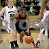 Monica Maschak - mmaschak@shawmedia.com<br /> DeKalb's Jasmine Malloy dribbles down the court in the fourth quarter at Rochelle on Friday, January 10, 2014. DeKalb won, 54-38.