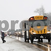 Rob Winner – rwinner@shawmedia.com<br /> <br /> A line of cars waits as a bus stops to drop off a child on Route 23 just north of Whipple Road in Sycamore, Ill., on Friday, Jan. 10, 2014. A new law that took effect this month allows school districts to install video cameras on buses to catch vehicles that pass stopped buses while dropping off or picking up students.
