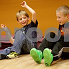 Monica Maschak - mmaschak@shawmedia.com<br /> Mattson Ber (left), 8, and Brian Mammoser, 9, finish a crab walking race during a Kidz Fit & Fun class at the Genoa Fitness Center on Thursday, January 9, 2014. The class is open to all kids on Tuesdays and Thursdays.