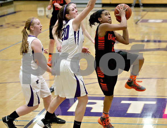 Monica Maschak - mmaschak@shawmedia.com<br /> DeKalb's Ashlei Lopez prepares to shoot in the second quarter at Rochelle on Friday, January 10, 2014. DeKalb won, 54-38.