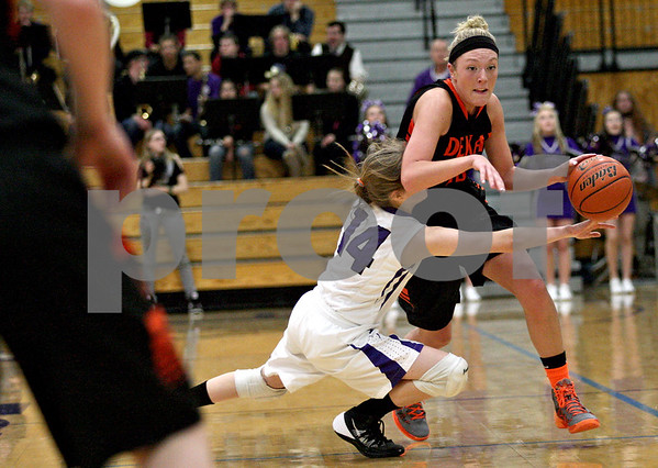 Monica Maschak - mmaschak@shawmedia.com<br /> DeKalb's Madelyne Johnson collides with a defender in the fourth quarter at Rochelle on Friday, January 10, 2014. DeKalb won, 54-38.