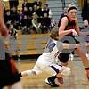 Monica Maschak - mmaschak@shawmedia.com<br /> DeKalb's Madelyne Johnson collides with a defender in the fourth quarter at Rochelle on Friday, January 10, 2014. DeKalb won, 54-38.