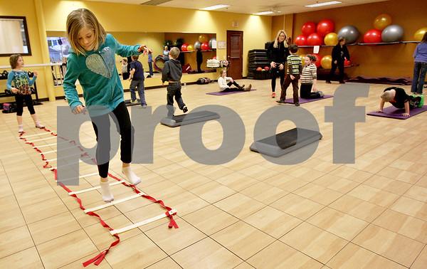 Monica Maschak - mmaschak@shawmedia.com<br /> Bridget Hughes, 9, hops on one leg between the rungs of a ladder during a Kidz Fit & Fun class at the Genoa Fitness Center on Thursday, January 9, 2014. The class is open to all kids on Tuesdays and Thursdays.