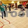Monica Maschak - mmaschak@shawmedia.com<br /> Bridget Hughes, 9, hops on one leg between the rungs of a ladder during a Kidz Fit & Fun class at the Genoa Fitness Center on Thursday, January 9, 2014. The class is open to all kids on Tuesdays and Thursdays.