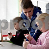 Monica Maschak - mmaschak@shawmedia.com<br /> Youth Development Director Lesley Feyerherm (middle) helps Kaylee Luetkebuenger (left), 9, and Jenna Luetkebuenger, 5, with their crafts during the No School, No Problem program at Kishwaukee YMCA on Tuesday, January 7, 2014. The program is offered to kids with working parents when schools are closed.