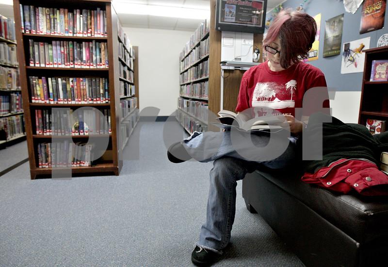 Monica Maschak - mmaschak@shawmedia.com<br /> Abby Zaccaria, 18, of Rochelle flips through a book at DeKalb Library on Thursday, January 2, 2014.
