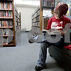 Monica Maschak - mmaschak@shawmedia.com<br /> Abby Zaccaria, 18, of Rochelle flips through a book at DeKalb Library on Thursday, January 2, 2014.