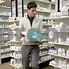 Monica Maschak - mmaschak@shawmedia.com<br /> Pharmacy Technician Marshall Lubbers places drugs back on the shelves at Lehan Drugs on Thursday, January 2, 2014.