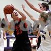 Monica Maschak - mmaschak@shawmedia.com<br /> DeKalb's Madelyne Johnson aims over two defenders in the third quarter at Rochelle on Friday, January 10, 2014. DeKalb won, 54-38.