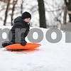 Monica Maschak - mmaschak@shawmedia.com<br /> Aden Schultz, 6, skims his way down the hill at the Russell Woods Forest Preserve in Genoa on Saturday, January 11, 2014.