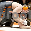 Monica Maschak - mmaschak@shawmedia.com<br /> DeKalb's Alex Roach puts his weight on Sycamore's Devin Knight in the 285-pound match at DeKalb High School on Thursday, January 16, 2014. Roach won the match, 2-0. DeKalb won the meet, 51-8.