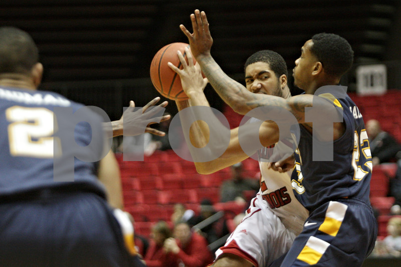 Rob Winner – rwinner@shawmedia.com<br /> <br /> Northern Illinois guard Aaron Armstead (left) is pressured by Kent State's Derek Jackson during the first half of their game at the Convocation Center in DeKalb, Ill., Wednesday, Jan. 15, 2014.