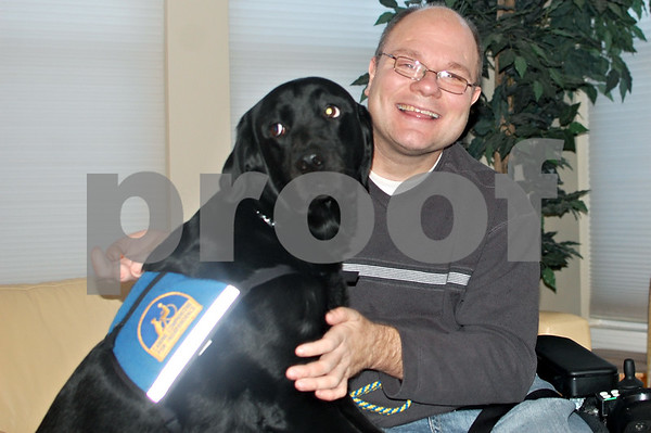 Debbie Behrends – dbehrends@shawmedia.com<br /> <br /> Steve Karmgard and his service dog, Pluto<br /> <br /> Wednesday, Jan. 8, 2014