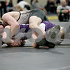 Monica Maschak - mmaschak@shawmedia.com<br /> Sycamore's Kyle Akins (top) pins Hononegah's Keegan Powers in the 120-pound championship match at Saturday's Sycamore Invitational. Akins won, 3-0.