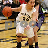 Monica Maschak - mmaschak@shawmedia.com<br /> Sycamore's Julia Moll surveys the court in the first quarter against Hampshire at Sycamore High School on Tuesday, January 14, 2014. Sycamore won, 47-29.