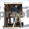 Rob Winner – rwinner@shawmedia.com<br /> <br /> Jose Garcia, a subcontractor of Silverthorne Homebuilders, works on a window frame during the construction of a new home in the North Grove Crossings subdivision in Sycamore, Ill., Thursday, Jan. 9, 2014.