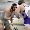 Monica Maschak - mmaschak@shawmedia.com<br /> McHenry's Luis Hernandez (gray) wrestles against Hononegah's Blake Zalapi in the 220-pound championship match at Saturday's Sycamore Invitational. Hernandez won, 9-0.