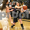 Monica Maschak - mmaschak@shawmedia.com<br /> Hampshire's Sara Finn looks to pass in the fourth quarter against Sycamore at Sycamore High School on Tuesday, January 14, 2014. Hampshire lost, 47-29.