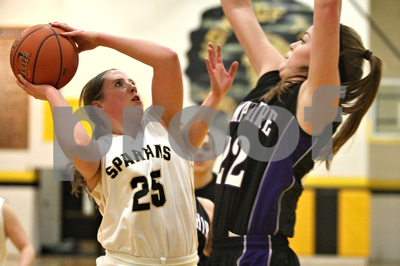 Monica Maschak - mmaschak@shawmedia.com<br /> Sycamore's Bailey Gilbert shoots the ball in the first quarter against Hampshire at Sycamore High School on Tuesday, January 14, 2014. Sycamore won, 47-29.