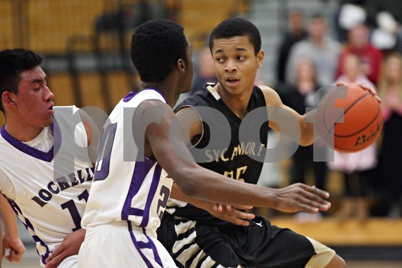 Rob Winner – rwinner@shawmedia.com<br /> <br /> Sycamore's Daniel Evans (right) is pressured by a pair of Rochelle defenders during the first half in Rochelle, Ill., Friday, Jan. 17, 2014. Sycamore defeated Rochelle, 76-49.