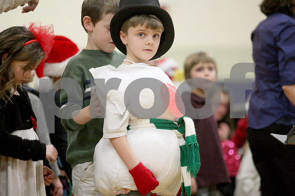 Monica Maschak - mmaschak@shawmedia.com<br /> Thomas Giebel, dressed as Melton, the warm-hearted snowman, stands in front of his peers during Hiawatha Elementary's kindergarten through second grade Winter Music Program on Wednesday, January 15, 2014.