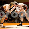 Monica Maschak - mmaschak@shawmedia.com<br /> Sycamore's Chris Malone (left) faces off with DeKalb's Leif Williams in the 182-pound match at DeKalb High School on Thursday, January 16, 2014. Malone won the match, 5-3. DeKalb won the meet, 51-8.