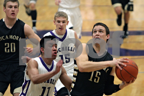 Rob Winner – rwinner@shawmedia.com<br /> <br /> Sycamore's Devin Mottet (15) drives to the basket during the first quarter in Rochelle, Ill., Friday, Jan. 17, 2014. Sycamore defeated Rochelle, 76-49.