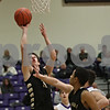 Rob Winner – rwinner@shawmedia.com<br /> <br /> Sycamore's Logan Wright (left) puts up a shot good for two points during the first half in Rochelle, Ill., Friday, Jan. 17, 2014. Sycamore defeated Rochelle, 76-49.