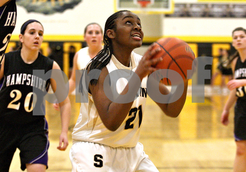 Monica Maschak - mmaschak@shawmedia.com<br /> Sycamore's Taiya Hopkins prepares to shoot in the first quarter against Hampshire at Sycamore High School on Tuesday, January 14, 2014. Sycamore won, 47-29.