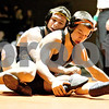 Monica Maschak - mmaschak@shawmedia.com<br /> Sycamore's Kyle Akins (left) wrestles DeKalb's Parker Stratton in the 126-pound match at DeKalb High School on Thursday, January 16, 2014. Akins won the match, 8-1. DeKalb won the meet, 51-8.