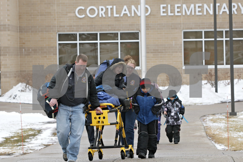 Rob Winner – rwinner@shawmedia.com<br /> <br /> A young boy is seen on a stretcher taken from Cortland Elementary School in Cortland, Ill., on Tuesday, Jan. 14, 2014. Gas released from the nearby landfill got caught in the school's ventilation system making staff and students nauseous. Emergency personnel from fire departments including Cortland, DeKalb, Sycamore, Maple Park-Countryside, Elburn, Burlington, Hinckley and Genoa-Kingston were seen at the school.<br /> <br /> ***Feel free to crop in closer. -Rob***