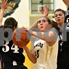 Monica Maschak - mmaschak@shawmedia.com<br /> Sycamore's Bailey Gilbert eyes the hoop in the first quarter against Hampshire at Sycamore High School on Tuesday, January 14, 2014. Sycamore won, 47-29.