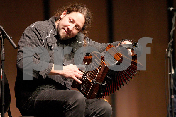 Monica Maschak - mmaschak@shawmedia.com<br /> Rejean Brunet, with French-Canadian folk group Le Vent du Nord, plays the accordian at DeKalb High School on Tuesday, January 14, 2014. A public concert will be held at the high school this Saturday at 7 p.m.