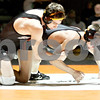 Monica Maschak - mmaschak@shawmedia.com<br /> Sycamore's Kyle Akins (left) moves DeKalb's Parker Stratton to the mat in the 126-pound match at DeKalb High School on Thursday, January 16, 2014. Akins won the match, 8-1. DeKalb won the meet, 51-8.